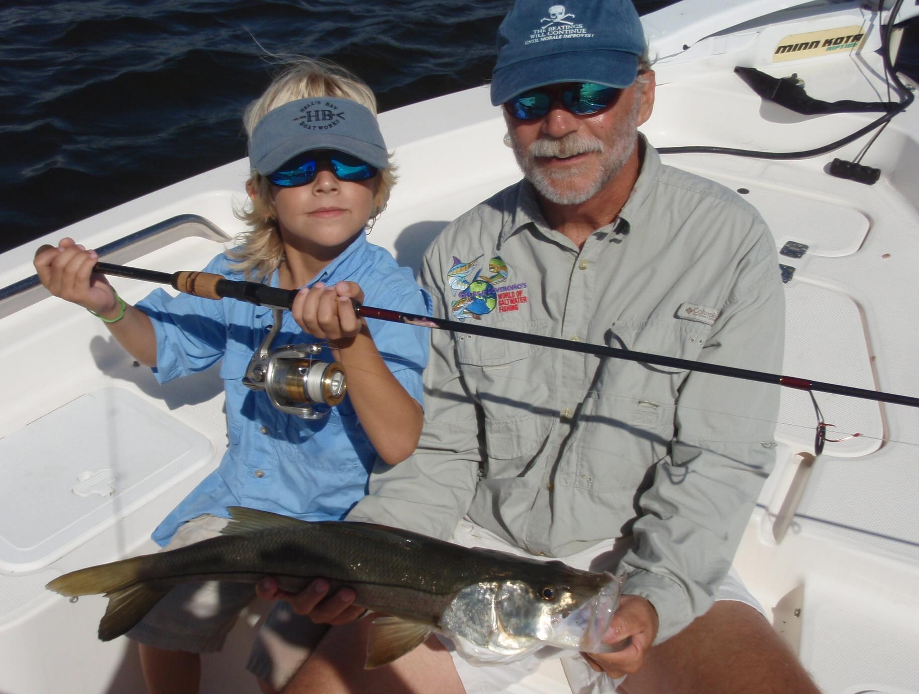 Mr. Bob Chew, General Manager of Albury Brothers Boats in Florida, and his 7-year-old son AJ with a nice Snook on his Smith & Albury Custom.